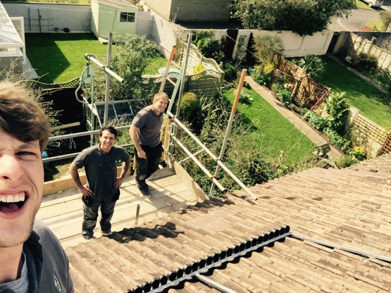 Gloucestershire Plumbers on roof.